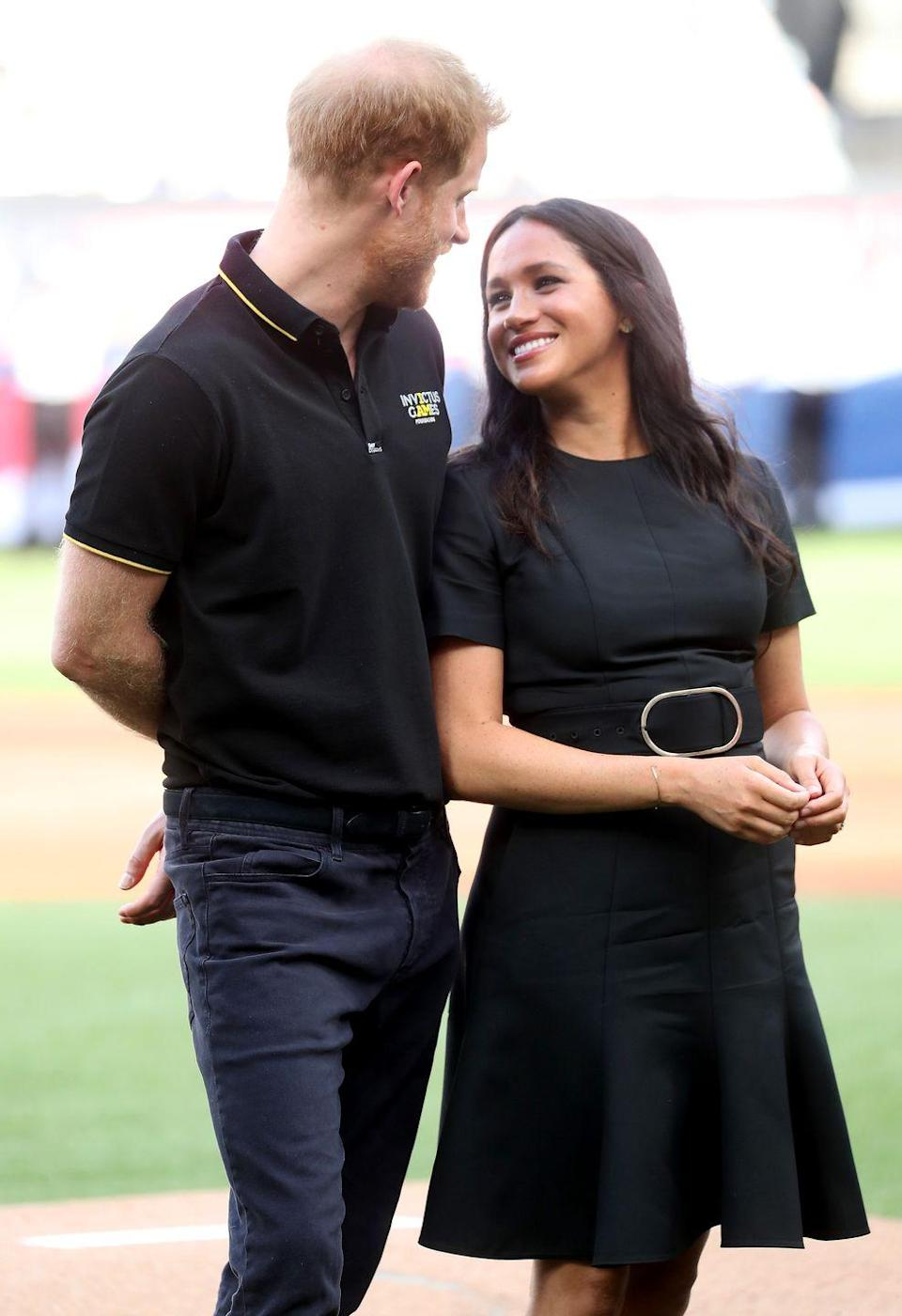 <p>Harry smiles down at Meghan as they attend the Boston Red Sox against the New York Yankees baseball game at London Stadium.</p>