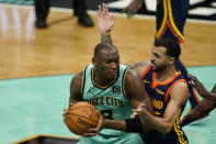 Charlotte Hornets center Bismack Biyombo, left, drives to the basket past Golden State Warriors guard Mychal Mulder during the second half of an NBA basketball game on Saturday, Feb. 20, 2021, in Charlotte, N.C. (AP Photo/Chris Carlson)