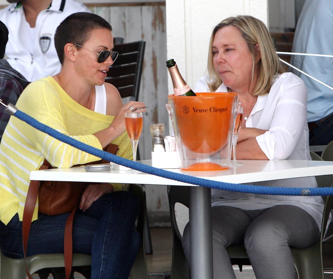 "Charlize Theron and her mother Gerda at a trendy Camps Bay pavement eatery, Cafe Caprice, on November 16, 2012 in Cape Town, South Africa. The actress is in Cape Town to shoot the final scenes for the Australian blockbuster ""Mad Max 4: Fury Road"".(Photo by Esa Alexander / Sunday Times / Gallo Images / Getty Images )"