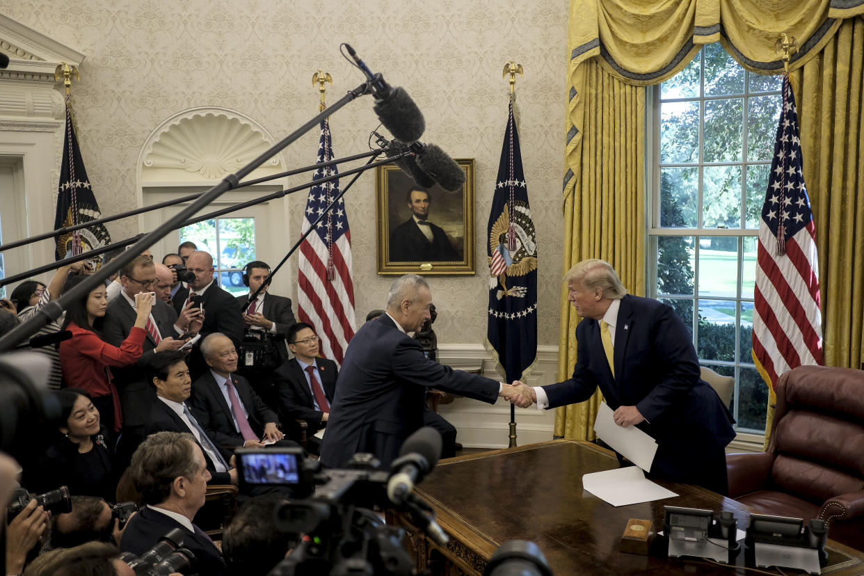 President Donald Trump greets Vice Premier Liu He of China in the Oval Office of the White House in Washington on Friday, Oct. 11, 2019. (Gabriella Demczuk/The New York Times)