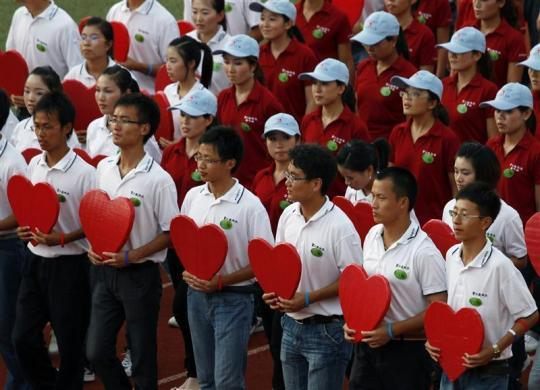 "Workers from Foxconn take part in a ""Treasure Your Life"" rally inside a stadium at a Foxconn plant in the southern Chinese township of Longhua in Guangdong province August 18, 2010."