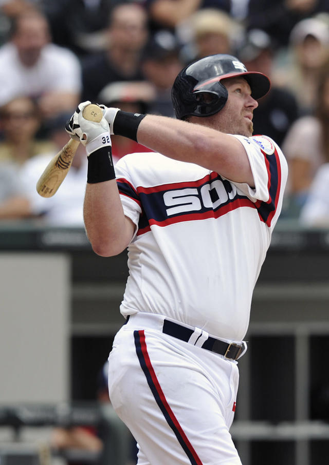 Chicago White Sox's Adam Dunn watches his solo home run against the Kansas City Royals during the sixth inning of a baseball game on Sunday, July 28, 2013, in Chicago. (AP Photo/Jim Prisching)