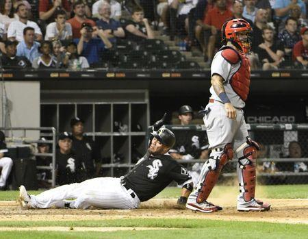 Jul 11, 2018; Chicago, IL, USA; Chicago White Sox second baseman Yoan Moncada (10) is safe at home as St. Louis Cardinals catcher Yadier Molina (4) stands nearby at Guaranteed Rate Field. Mandatory Credit: David Banks-USA TODAY Sports
