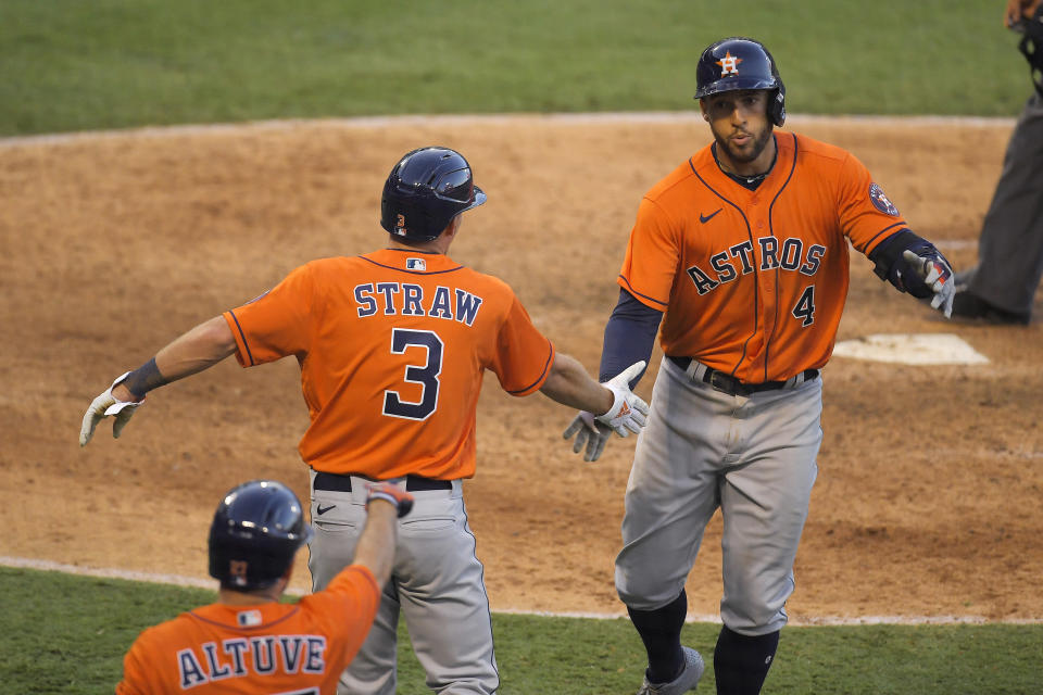 Houston Astros' George Springer, right, is congratulated by Myles Straw, center, and Jose Altuve after hitting a two-run home run during the ninth inning of a baseball game against the Los Angeles Angels, Saturday, Aug. 1, 2020, in Anaheim, Calif. (AP Photo/Mark J. Terrill)