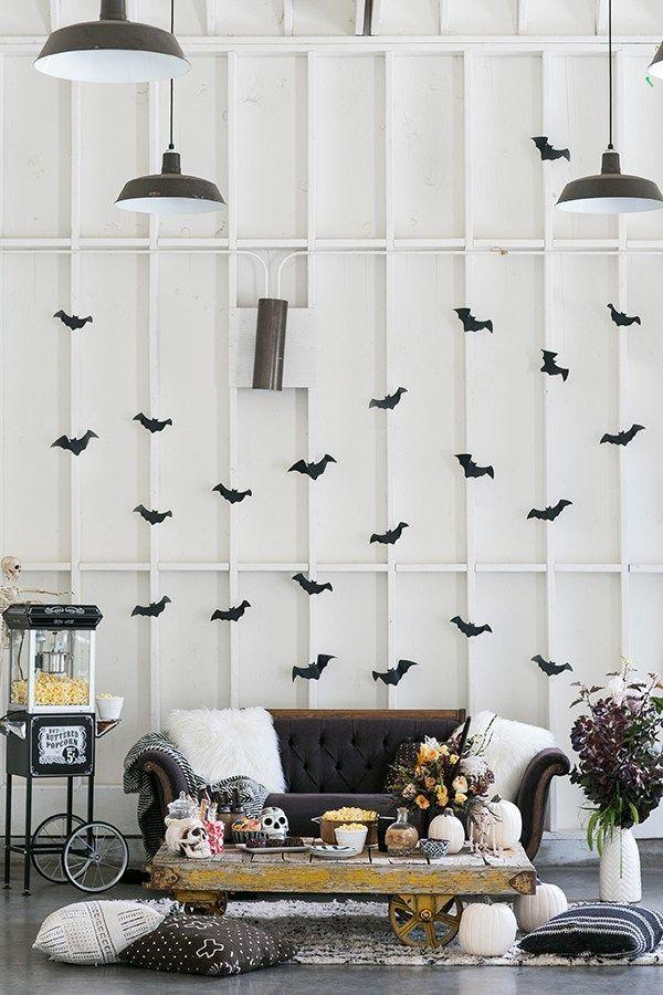 "<p>Hosting a Halloween movie extravaganza doesn't have to mean whipping out the <a href=""https://www.countryliving.com/life/entertainment/g22119835/netflix-halloween-movies/"" rel=""nofollow noopener"" target=""_blank"" data-ylk=""slk:scariest horror movie"" class=""link rapid-noclick-resp"">scariest horror movie</a>s in your collection! Take a page out of this blogger's book and keep things lighthearted, chic, and modern.</p><p><strong>Get the tutorial at <a href=""https://sugarandcharm.com/2016/09/charming-halloween-movie-night.html?section-4"" rel=""nofollow noopener"" target=""_blank"" data-ylk=""slk:Sugar and Charm"" class=""link rapid-noclick-resp"">Sugar and Charm</a>.</strong></p><p><a class=""link rapid-noclick-resp"" href=""https://www.amazon.com/Halloween-Decorations-Decals-Supplies-Assorted/dp/B075L8683Y?tag=syn-yahoo-20&ascsubtag=%5Bartid%7C10050.g.4620%5Bsrc%7Cyahoo-us"" rel=""nofollow noopener"" target=""_blank"" data-ylk=""slk:SHOP BAT DECALS"">SHOP BAT DECALS</a></p>"