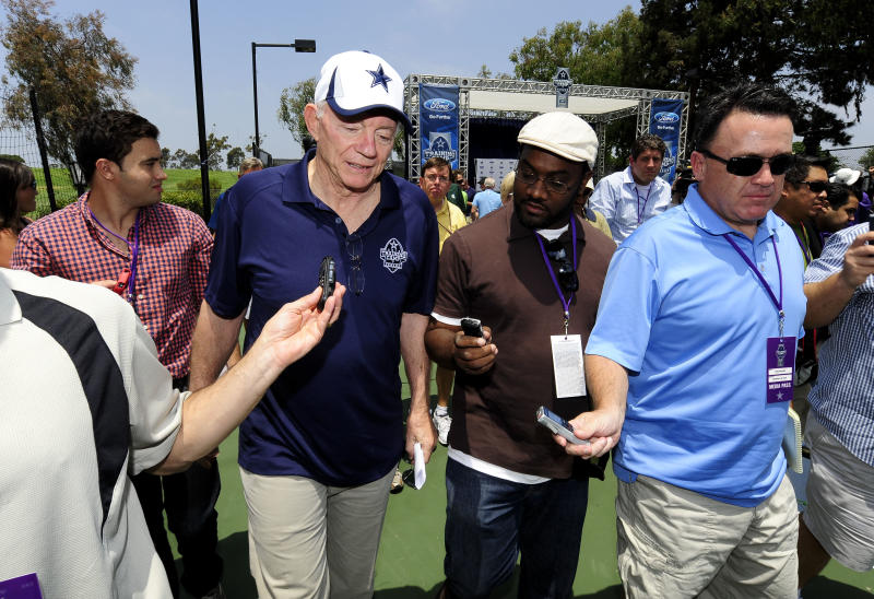 Dallas Cowboy owner Jerry Jones answers questions from reporters as he leaves the state of the Cowboys address at NFL football training camp, Saturday, July 20, 2013, in Oxnard, Calif. (AP Photo/Gus Ruelas)