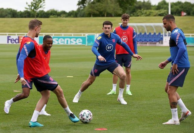 Harry Maguire (centre) joins in training with his England team-mates
