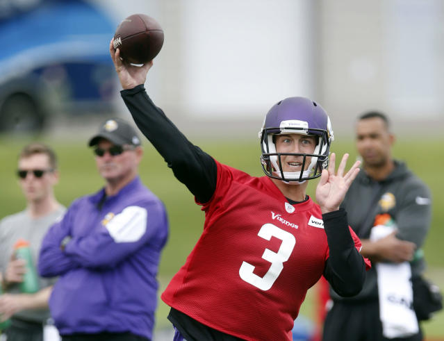 FILE - In this July 26, 2018, file photo, Minnesota Vikings quarterback Trevor Siemian throws a pass during NFL football training camp in Eagan, Minn. Barring injury, Siemian will be the backup to Kirk Cousins, who signed a three-year, $84 million contract as Minnesota's starter. (AP Photo/Jim Mone, File)