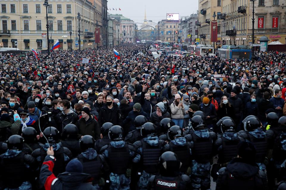 <p>Police and protesters face off during a huge rally in Saint Petersburg</p> (Reuters)