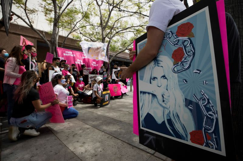 A supporter holds a poster during a rally for pop star Britney Spears during a conservatorship case hearing at Stanley Mosk Courthouse in Los Angeles