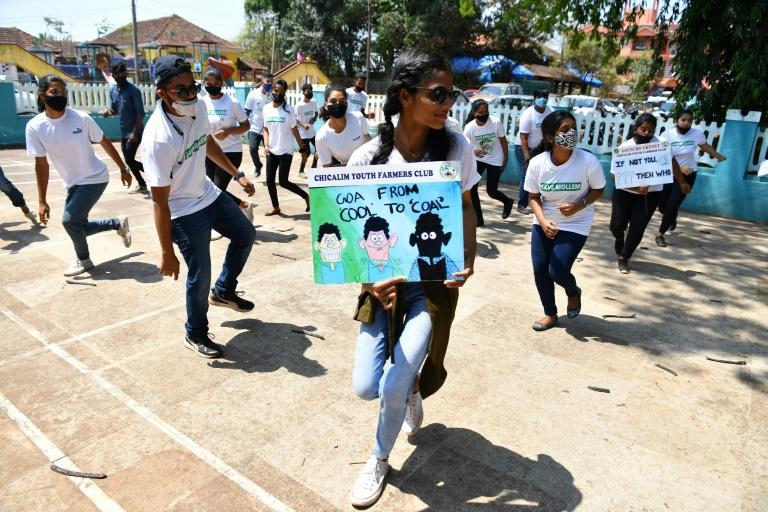 Neola Sybil Pereira (C) dances with other activists during a flashmob at Altona in Goa, where a growing, youth-led environmental movement is rattling Indian authorities