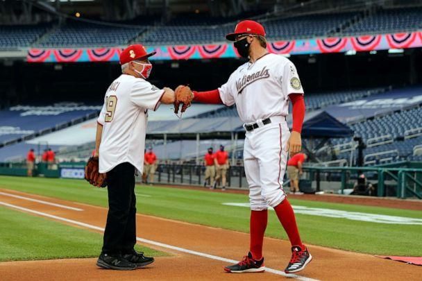 PHOTO: Dr. Anthony Fauci is greeted by Sean Doolittle of the Washington Nationals after throwing out the ceremonial first pitch prior to the game between the New York Yankees and the Washington Nationals at Nationals Park on July 23, 2020, in Washington. (Alex Trautwig/MLB Photos via Getty Images)