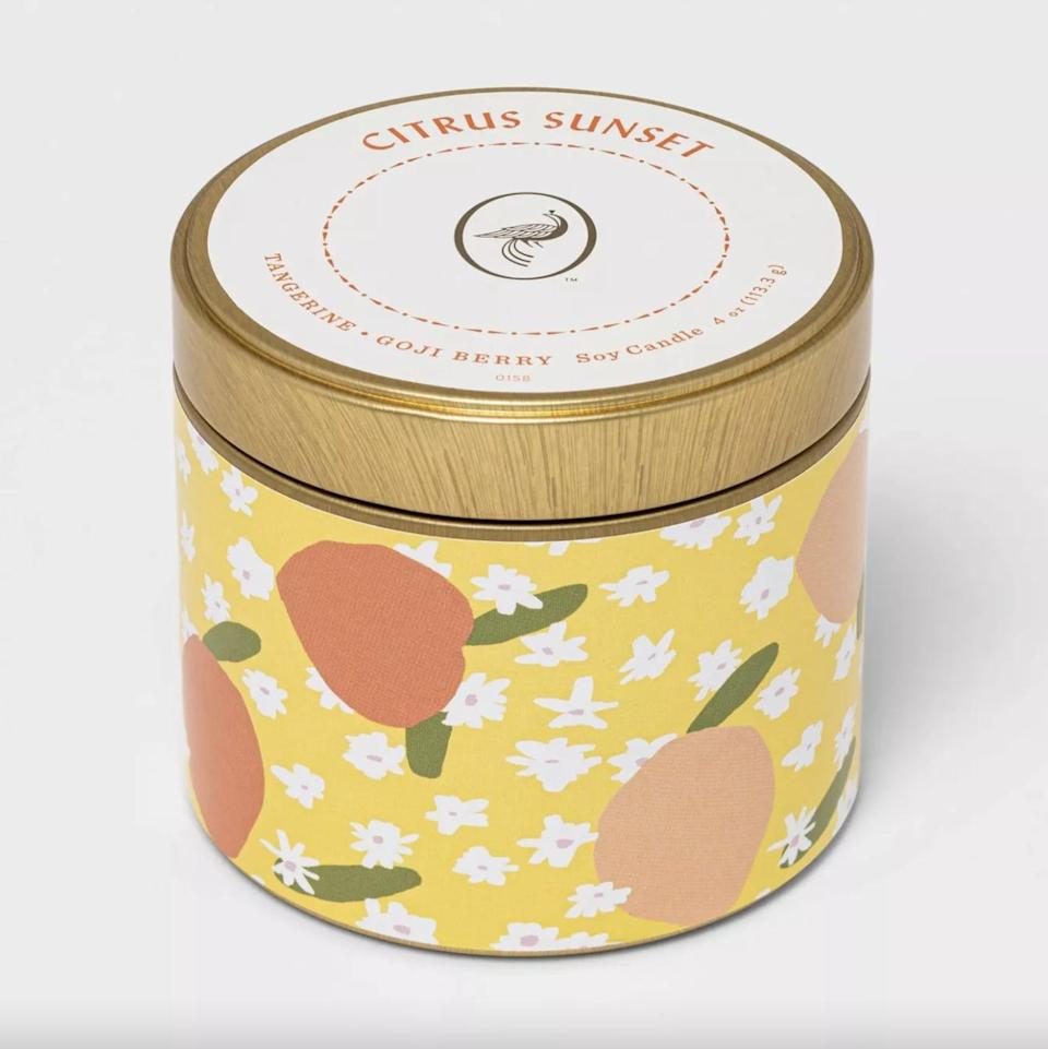 <p>This <span>Mini Patterned Tin Citrus Sunset Candle</span> ($4) features notes of goji berry, citrus, and tangerine, meaning it smells just like a summertime vacation.</p>
