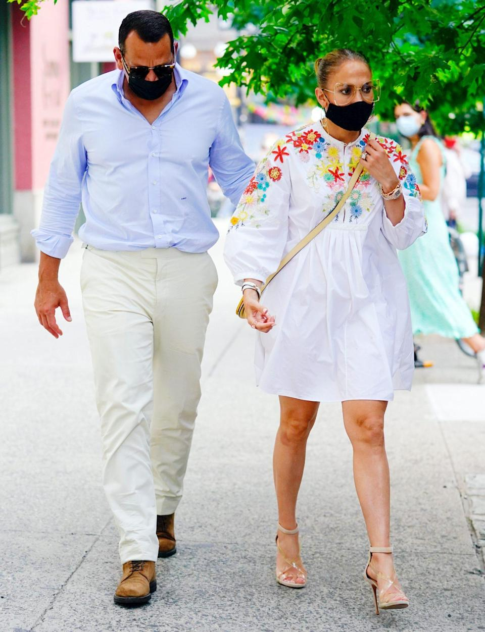 <p>Jennfier Lopez and Alex Rodriguez make their way through N.Y.C. on Wednesday in summery outfits and matching black masks.</p>