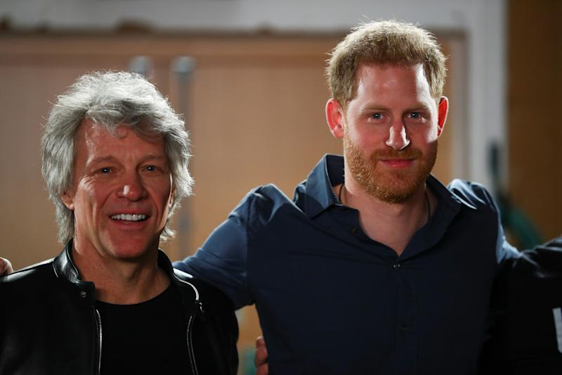 Britain's Prince Harry, Duke of Sussex (R) and US singer Jon Bon Jovi pose as hey meet with members of the Invictus Games Choir at Abbey Road Studios in London on February 28, 2020, where they were to record a special single in aid of the Invictus Games Foundation. (Photo by HANNAH MCKAY / POOL / AFP) (Photo by HANNAH MCKAY/POOL/AFP via Getty Images)