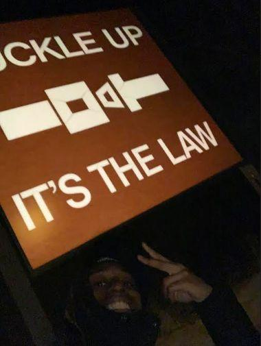 Jaylan Butler posed with a road sign near a rest stop in East Moline, Illinois, moments before police forced him to the ground and threatened to shoot him in the head, according to a lawsuit. (Photo: Jaylan Butler / ACLU of Illinois)