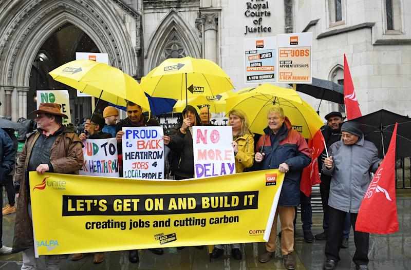 Campaigners outside the Royal Courts of Justice in London where a Court of Appeal ruling is taking place on the Heathrow expansion row. (PA)