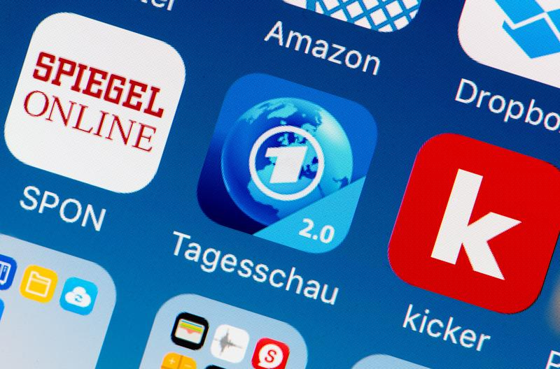 The icon of the new Tagesschau news app can be seen on a smartphone in Hamburg, Germany, 14 December 2016. The newly designed app of the German public broadcasting news show presents videos in upright format. Photo: Daniel Reinhardt/dpa   usage worldwide (Photo by Daniel Reinhardt/picture alliance via Getty Images)