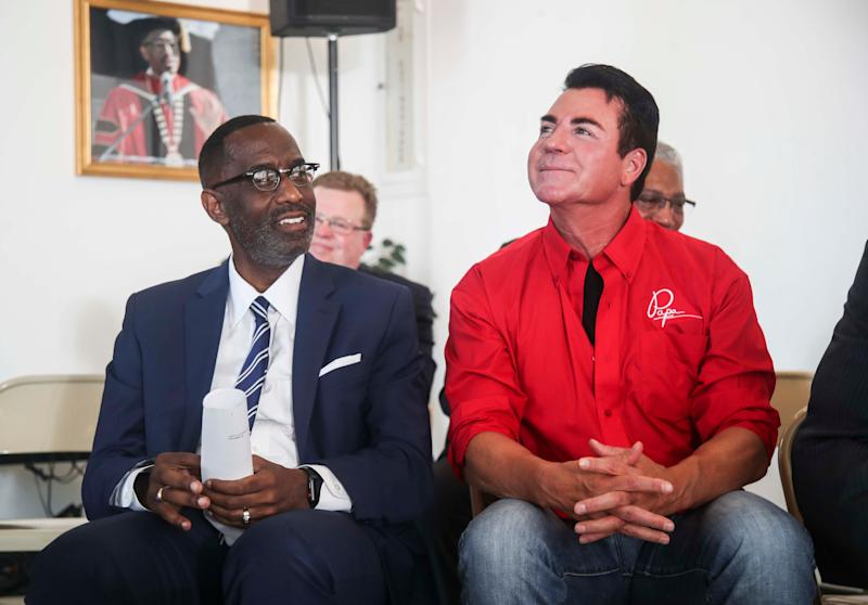 Papa John's founder John Schnatter, right, sits with the Rev. Kevin Cosby at Simmons College on Wednesday afternoon at the private black college in Kentucky. Schnatter has donated $1 million to the school.