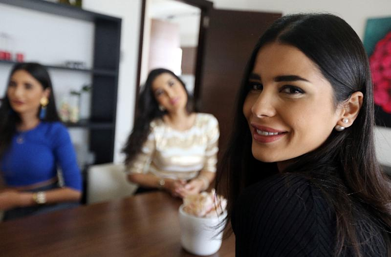 """(L-R) Alice, Nadine and Farah, stars of Lebanese reality TV show """"The Sisters"""", pictured at their villa in the upscale area of Beit-Misk, northeast of Beirut (AFP Photo/Joseph Eid)"""
