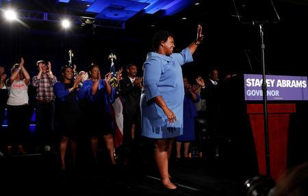 Georgia Democratic gubernatorial nominee Stacey Abrams waves to supporters during a midterm election night party in Atlanta, Georgia, U.S., November 7, 2018. REUTERS/Leah Millis