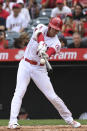 Los Angeles Angels designated hitter Shohei Ohtani hits into a fielder's choice during the first inning of a baseball game against the Seattle Mariners, Sunday, Sept. 26, 2021, in Anaheim, Calif. (AP Photo/Michael Owen Baker)