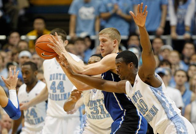 CHAPEL HILL, NC - FEBRUARY 08: Harrison Barnes #40 of the North Carolina Tar Heels dives for the ball against Mason Plumlee #5 of the Duke Blue Devils during their game at the Dean Smith Center on February 8, 2012 in Chapel Hill, North Carolina. (Photo by Streeter Lecka/Getty Images)