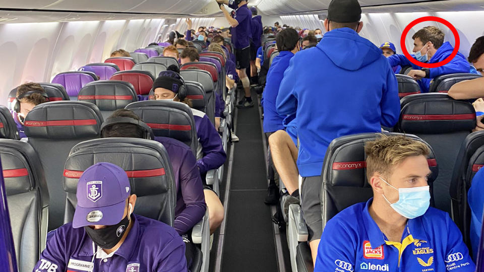 West Coast's Jamie Cripps, circled, wasn't wearing his mask correctly on a flight to Victoria.