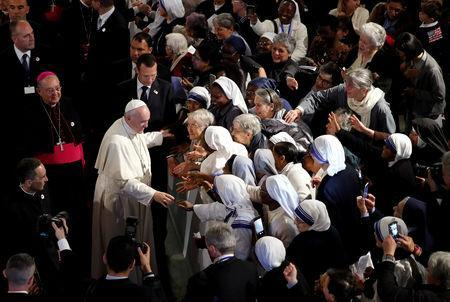 Pope Francis greets the faithful as he leaves Saint Peter's Cathedral in Rabat, Morocco, March 31, 2019. REUTERS/Remo Casilli