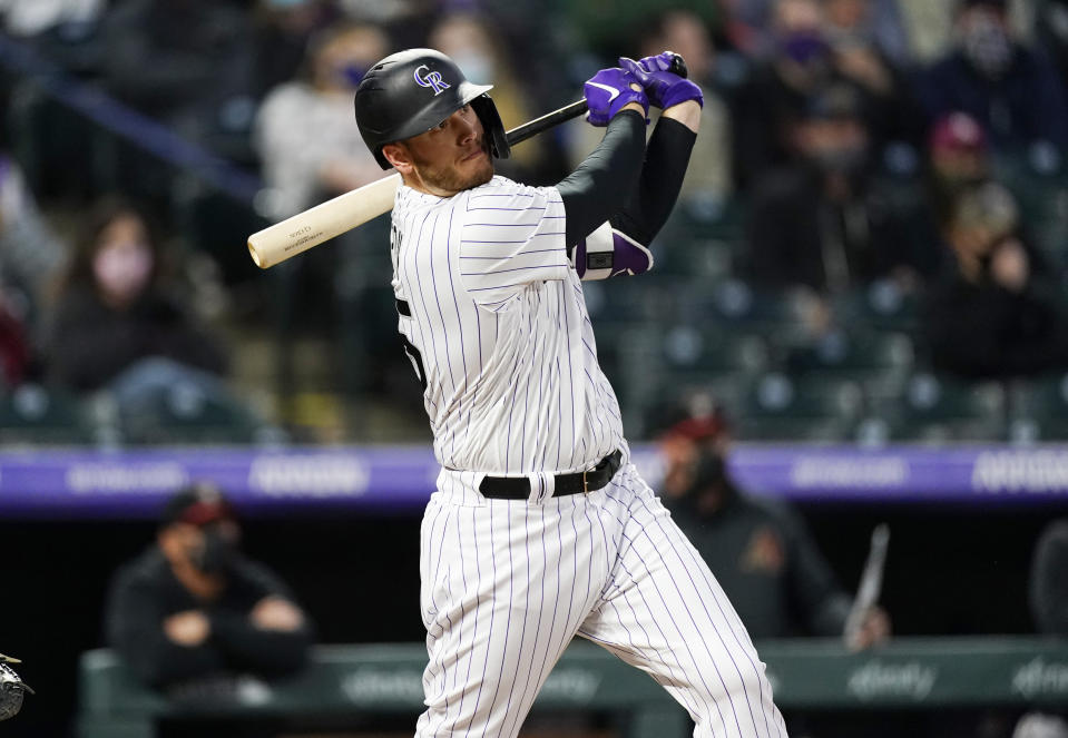 Colorado Rockies' C.J. Cron watches his RBI double off Arizona Diamondbacks starting pitcher Madison Bumgarner during the third inning of a baseball game Wednesday, April 7, 2021, in Denver. (AP Photo/David Zalubowski)