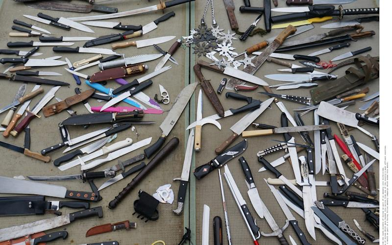 This array of dangerous-looking weapons was handed in from the leafy streets of Surrey as part of an amnesty into knife-crime - ©2017 INS Picture Desk/INS News Agency Ltd