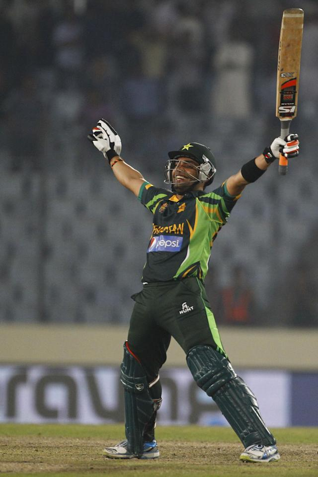 Pakistan's Umar Akmal celebrates after winning their match against Bangladesh in the Asia Cup one-day international cricket tournament in Dhaka, Bangladesh, Tuesday, March 4, 2014. (AP Photo/A.M. Ahad)