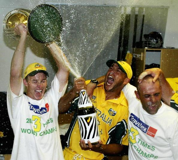 JOHANNESBURG - MARCH 23:  Brett Lee, Andrew Symonds and Darren Lehamann of Australia celebrate with the trophy and champagne in the rooms after the World Cup Final One Day International Match between Australia and India played at the Wanderers, Johannesburg, South Africa on March 23, 2003. Australia defeated India by 125 runs to win the World Cup (Photo by Hamish Blair/Getty Images)