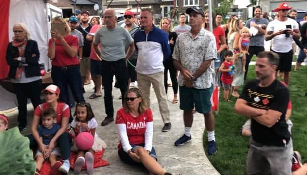 Noelle Montcalm's friends and family watch as Montcalm races the 400 metre hurdles in Tokyo (Jacob Barker/CBC - image credit)