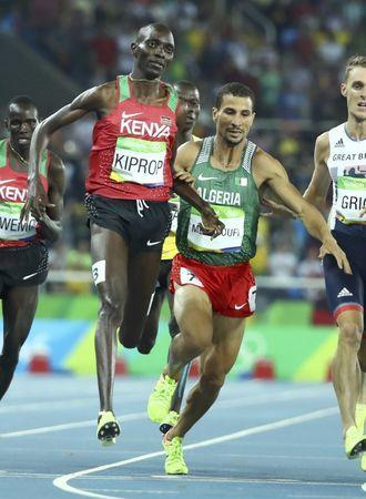 FILE PHOTO - 2016 Rio Olympics - Athletics - Final - Men's 1500m Final - Olympic Stadium - Rio de Janeiro, Brazil - 20/08/2016. Asbel Kiprop (KEN) of Kenya and Taoufik Makhloufi (ALG) of Algeria compete. REUTERS/Lucy Nicholson