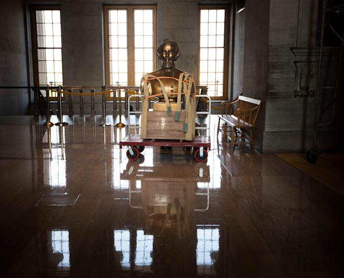 The Nathan Bedford Forrest bust is removed from the State Capitol Friday, July 23, 2021 in Nashville, Tenn.