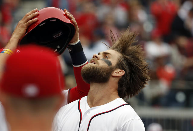 Bryce Harper's hair requires a little more work than you might expect. (AP Photo)