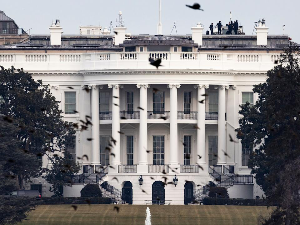 <p>A view of the White House the day after US President Donald J. Trump was impeached by the House of Representatives for his role in inciting a mob of his supporters on 06 January to riot at the US Capitol in an attempt to thwart Congress from certifying Biden's election victory in Washington, DC, on 14 January 2021</p> ((EPA))