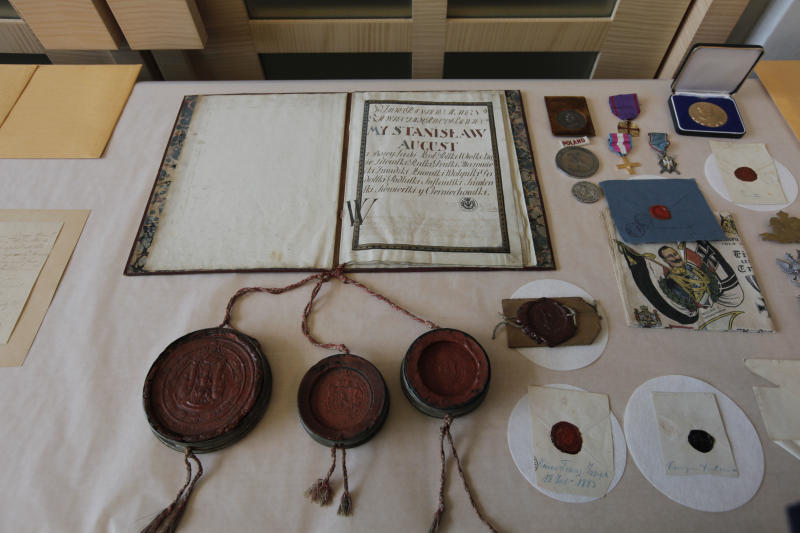 This photo taken Wednesday, June 20, 2012, at FBI Headquarters in Chicago, shows some of the more than 120 stolen artifacts missing for decades from the Chicago Polish Museum of America _ including letters with the signatures of Abraham Lincoln, Thomas Jefferson and American Revolution hero Thaddeus Kosciuszko that were returned to the Museum by the FBI on Wednesday. The items include letters and documents dating to the 18th and 19th centuries, seals, military medals and Nazi propaganda from World War II. The pieces, which the FBI valued at about $5 million, also included documentation about Napoleon, George Washington, John Adams and Polish kings. (AP Photo/M. Spencer Green)