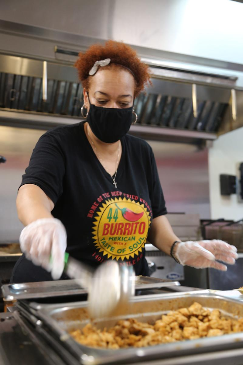 44 Burrito owner Tara Young prepares an order in the kitchen of her Mexican restaurant in Detroit on July 14, 2020.