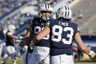 BYU tight end Carter Wheat, left, congratulates tight end Isaac Rex (83) for his touchdown in the first quarter against North Alabama during an NCAA college football game Saturday, Nov. 21, 2020, in Provo, Utah. (AP Photo/Jeff Swinger, Pool)