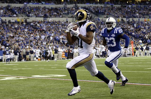 St. Louis Rams wide receiver Tavon Austin, left, makes a catch in front of Indianapolis Colts cornerback Vontae Davis on his way to a touchdown during the first half of an NFL football game in Indianapolis, Sunday, Nov. 10, 2013. (AP Photo/Darron Cummings)