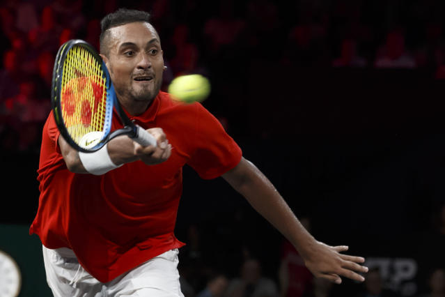 "FILE - In this Sept. 21, 2019 file photo, Nick Kyrgios returns a ball to Roger Federer during their singles match at the Laver Cup tennis event, in Geneva, Switzerland. Australia captain Lleyton Hewitt says he has been willing to overlook Kyrgios' recent outbursts on the ATP Tour to select the talented but wayward star in his team for the revamped Davis Cup finals. Kyrgios is currently serving six months probation on the ATP tour after a meltdown at the Cincinnati tournament in August and calling the ATP ""pretty corrupt"" during this year's US Open. (Salvatore Di Nolfi/Keystone via AP, File)"