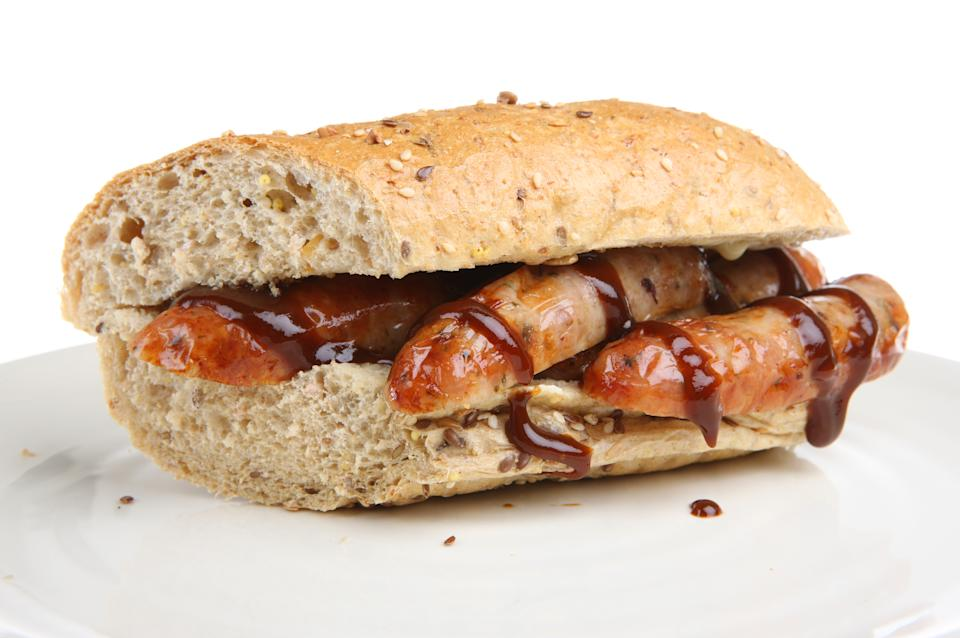Sausages in a wholemeal baguette with brown/barbecue sauce