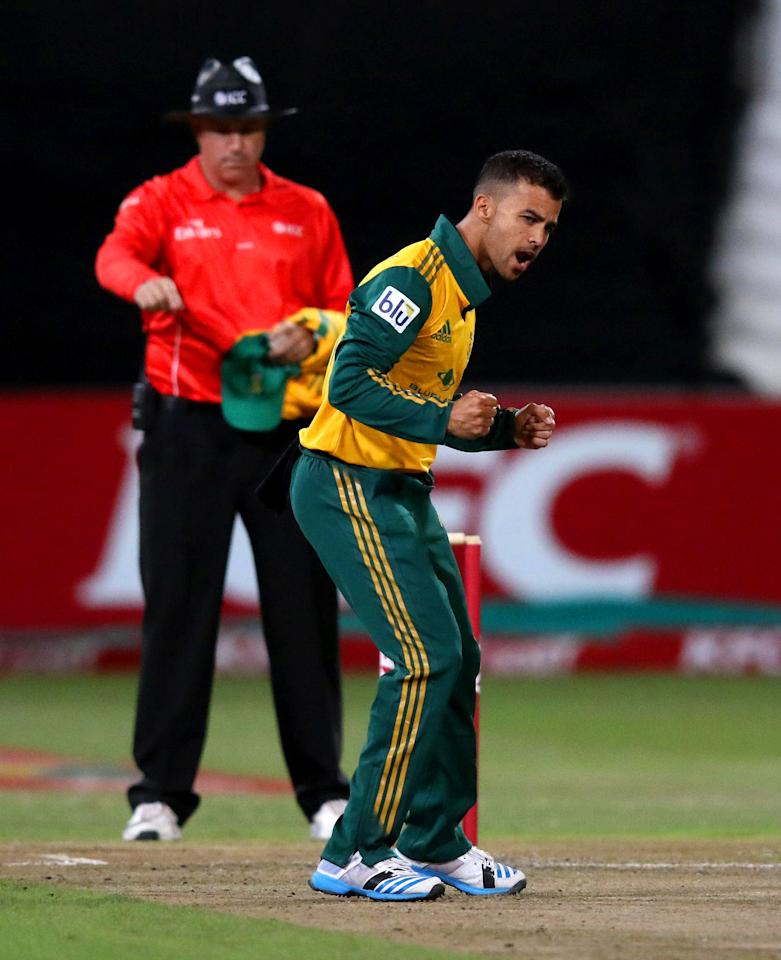 DURBAN, SOUTH AFRICA - MARCH 12:  JP Duminy of South Africa celebrates claiming David Warner of Australia's wicket during the 2nd T20 International match between South Africa and Australia at Sahara Stadium Kingsmead on March 12, 2014 in Durban, South Africa. (Photo by Anesh Debiky/Gallo Images/Getty Images)