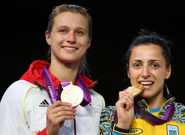 LONDON, ENGLAND - JULY 30: Silver medal winner Britta Heidemann (L) of Germany, and Gold medal winner Yana Shemyakina (R) of Ukraine pose after the Women's Epee Individual Fencing Finals on Day 3 of the London 2012 Olympic Games at ExCeL on July 30, 2012 in London, England. (Photo by Hannah Johnston/Getty Images)