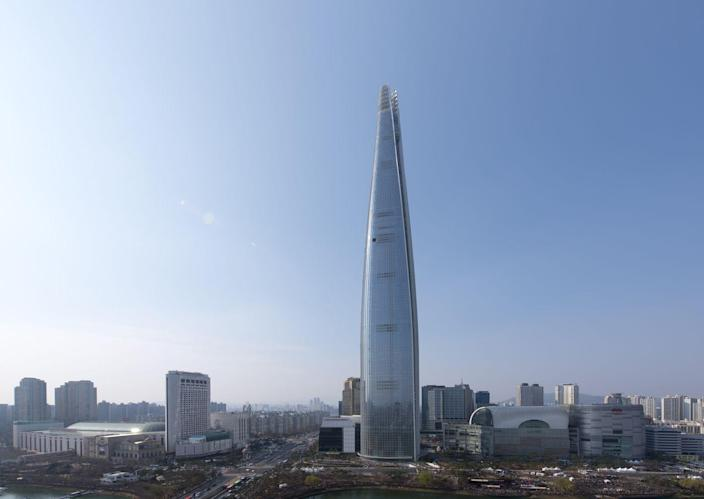 <p><strong>Location:</strong> Seoul, South Korea</p><p><strong>Height:</strong> 1,819 feet</p><p><strong>Completion date:</strong> 2017</p><p>The 123 floors of the Kohn Pedersen Fox Associates-designed Lotte World Tower became the first 100-story building in Korea. The steel building curves inward as it rises, and the glass used was meant to serve as a reminder to Korean ceramic history. A mix of retail, office, hotel, residence, and event space fills the tower.</p>