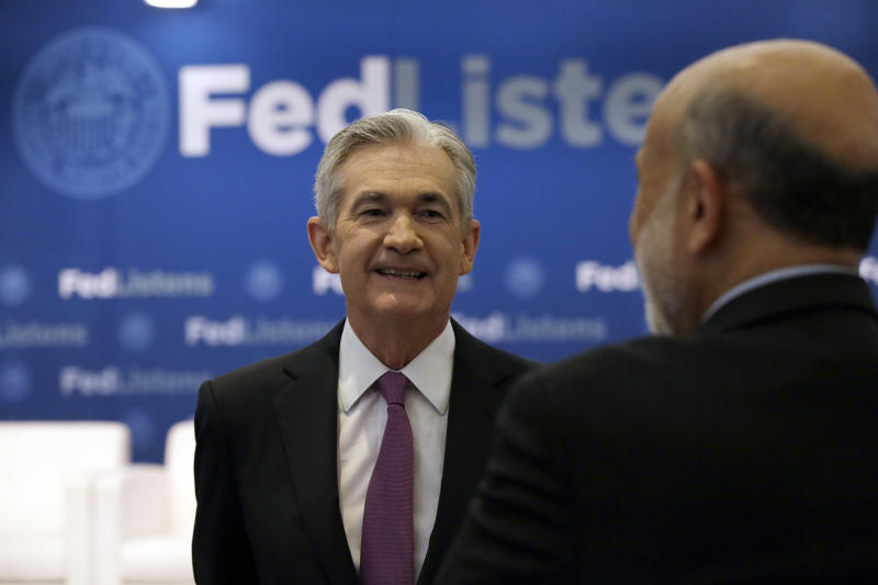 Federal Reserve Chairman Jerome Powell, left, talks to former Federal Reserve Chairs Ben Bernanke at a conference involving its review of its interest-rate policy strategy and communications, Tuesday, June 4, 2019, in Chicago. (AP Photo/Kiichiro Sato)