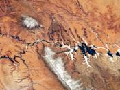 How's this for a view: An astronaut's photo from space captures a unique perspective of the Colorado plateau along the Utah-Arizona border. The confluence of the Colorado and San Juan rivers can also be seen -– the silvery section is sunlight reflected from the water. --Claudine Zap (Image credit: NASA)