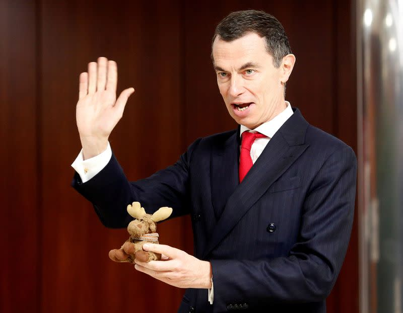 FILE PHOTO: Unicredit bank CEO Mustier holds his mascot Elkette during the UniCredit's shareholders meeting in Rome
